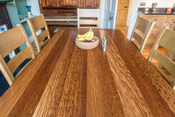 Trestle table top showing striped grain effect of the oak